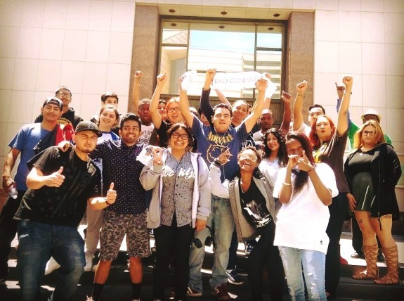 YJC FREE LA Victory pose BOS solitary confinement ban downtown steps all